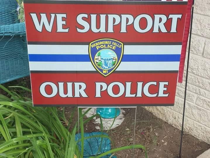 Picture of a sign that reads - We Support Our Police