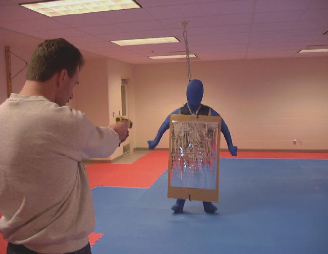 Man has target practice at dummy figure